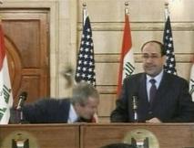 George Bush ducking the shoe.